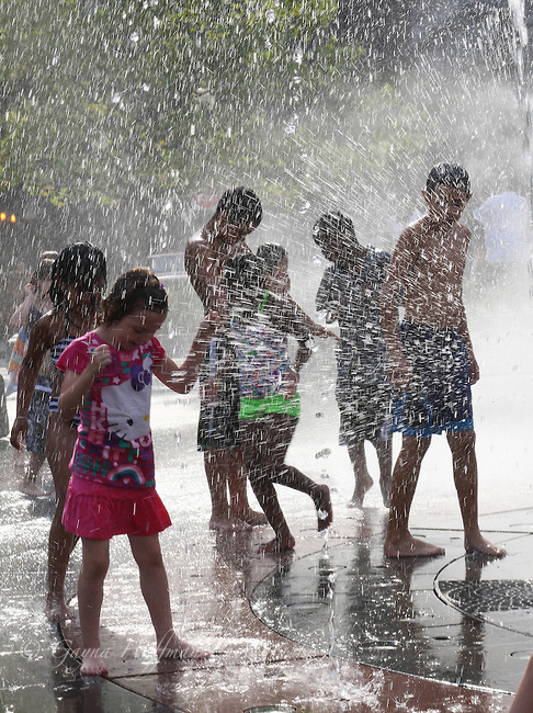 Children playing in water spouts, Boston, MA
